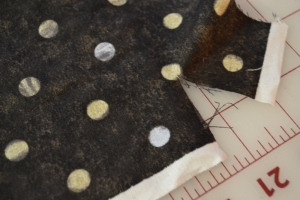 Make cut into the selvage edge of fabric